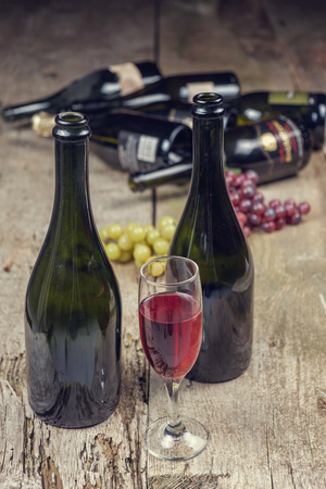 wine bottles on a old rusty wooden table