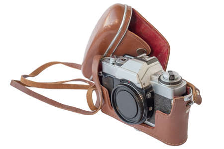 Old vintage camera in leather case on white background. isolated
