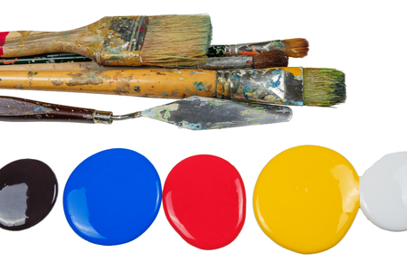 Set of oil paint brushes on a palette. white background, isolated Stock Photo