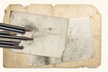 Drawing pencils and graphites on the old papers on a  white background, isolated