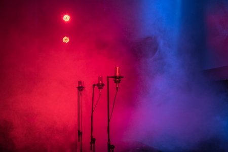 stage lights with smoke and microphones Stock fotó