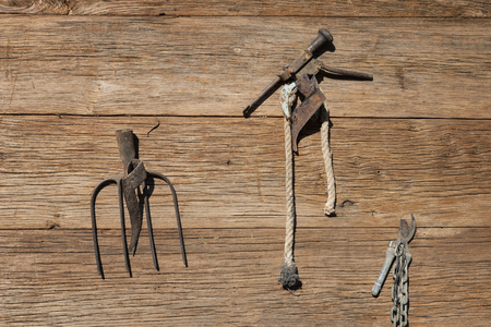 Iron tools on the wooden wall