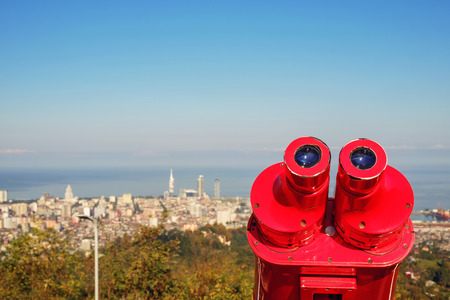 View of the blurred city from the red binocular