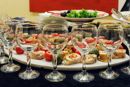 Empty glasses with mixed vegetables on the plate background