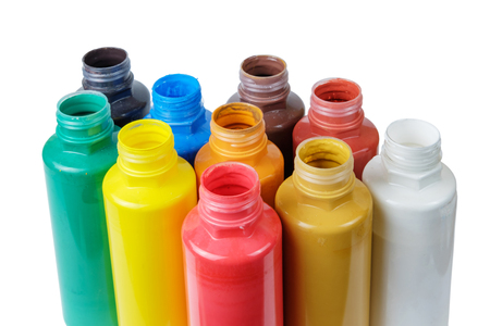 Acrylic paints in the plastic containers, isolated white background