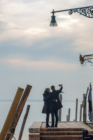 Couple on the pier taking a selfie