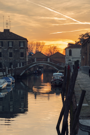 View of the canal at sunset in Venice at night Imagens