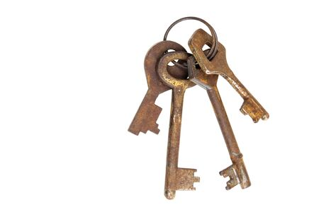 Old rusty keys isolated on a white background