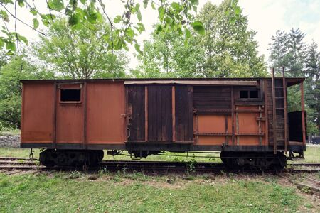 Old vintage abandoned wooden and metal  cargo train carriage