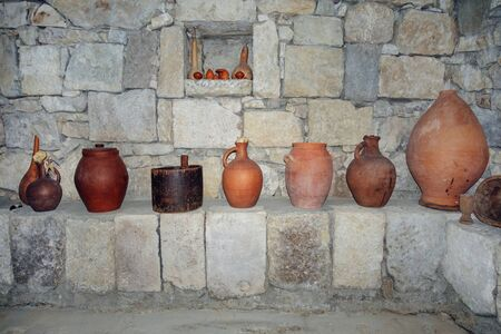 Traditional Georgian marani (cellar for storing wine in special pitchers) with wine making equipment