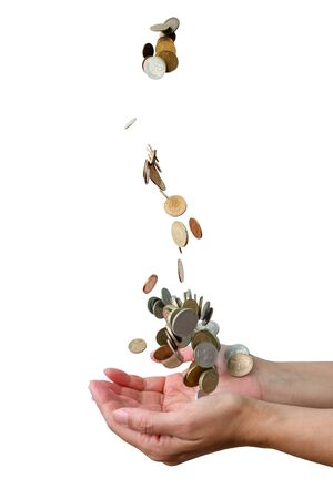Coins falling down in the palm of a hand, white background isolated Reklamní fotografie