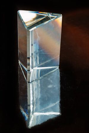 Glass Prism with reflection on Black Background Stock Photo