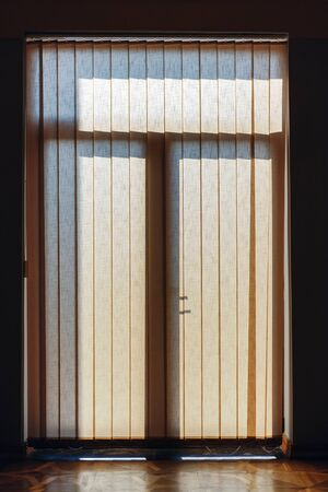 Window blinds in a room catching the sunlight 写真素材