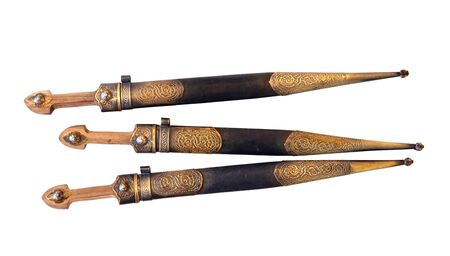Set of Georgian dagger with metal and leather scabbard on white background, isolated Фото со стока