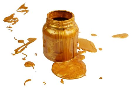 Pouring golden paint on the can, white background isolated