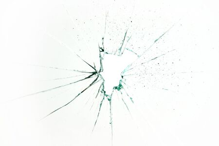broken and cracked glass with hole on a white background 版權商用圖片