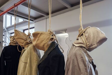 Prop bodies of a hanged men with sack on a head, selective focus