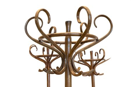 Detail of vintage wooden brown coat racks isolated on white background