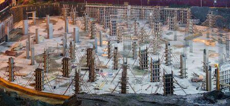 Empty illuminated construction site at night