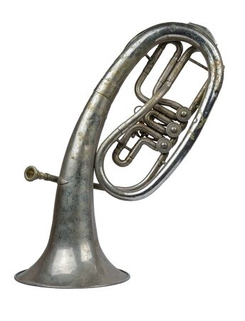 Old vintage tenor horn standing on a white background, isolated