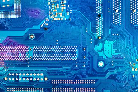Blue electronic circuit board background, close up