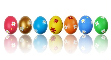 Set of colorful painted Easter eggs reflecting on the white background