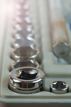 Metal wrench heads set closeup, soft focus