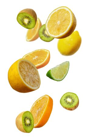 Falling fresh mixed citruses. Slices of the lemon, kiwi, and lime the air. Flying fruits concept isolated on the white background