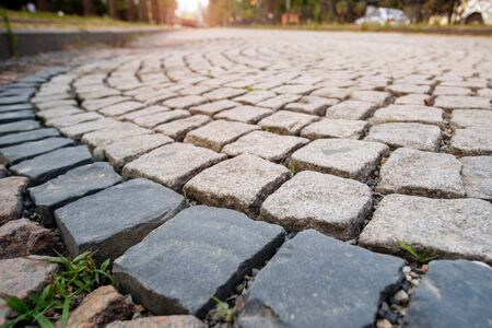 Pavement made from stone cubes in perspective, selective focus