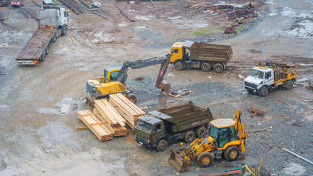 Special heavy construction equipment at a construction site on a muddy ground