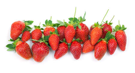 Fresh red strawberries on white background close-up. Top view