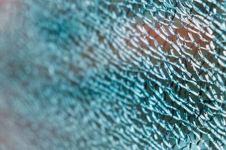 Abstract texture of cracked broken glass, selective focus