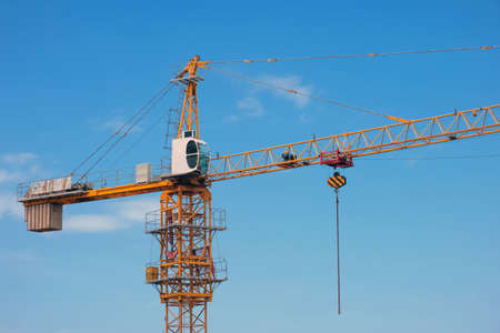 Construction crane on a blue sky background
