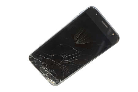 Black phone with broken screen isolated on a white background Foto de archivo