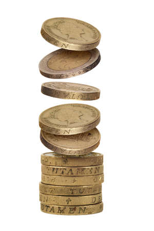 Stack of falling one pound and two euro coins Isolated on white background