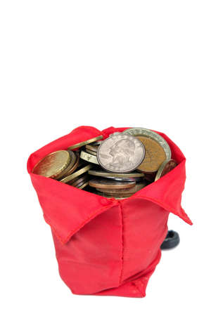 Red pouch full of money coins isolated on a white background