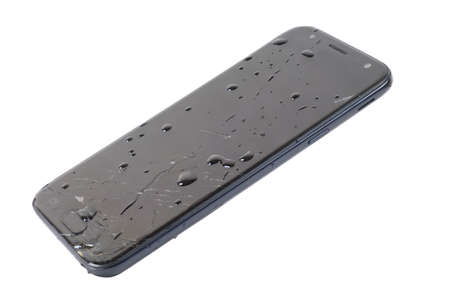 Black phone with broken screen and covered with water drops isolated on white background Banque d'images - 159028611
