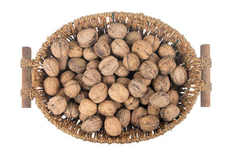 Whole walnuts in the basket, isolated on white background, top view Banque d'images