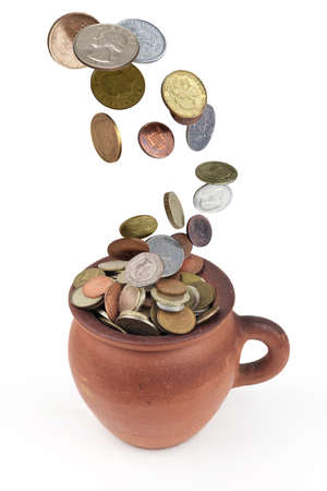 Money coins rain falling down in to the clay pot, isolated on a white background