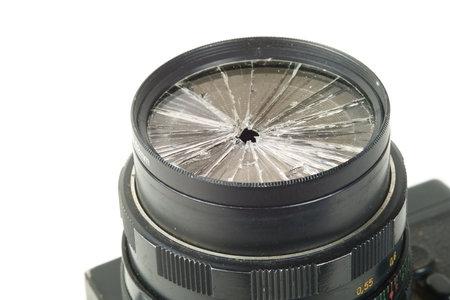 broken lens on the old vintage film camera, closeup