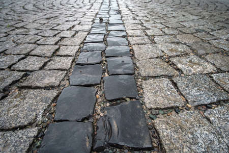 Traditional color stone wet pavement in perspective, selective focus