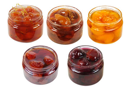 A set of various jams in a transparent glass jars isolated on a white background 版權商用圖片