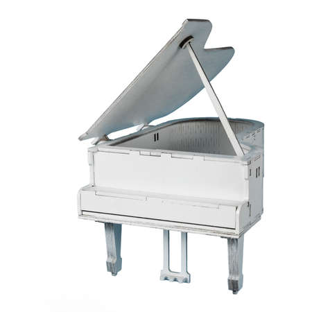 Decorative toy white grand piano isolated on a white background