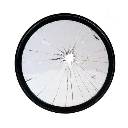 Broken camera lens filter on white background 版權商用圖片