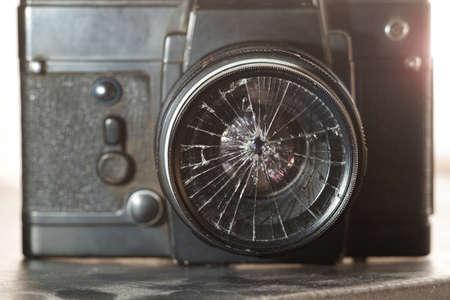 broken lens on the old vintage film camera, selective focus