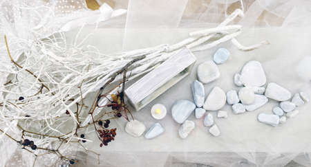 Still life with painted white pebbles and branches