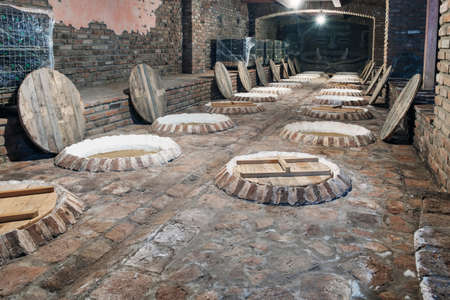 Interior of a traditional Georgian wine cellar marani for processing and fermentation of wine production