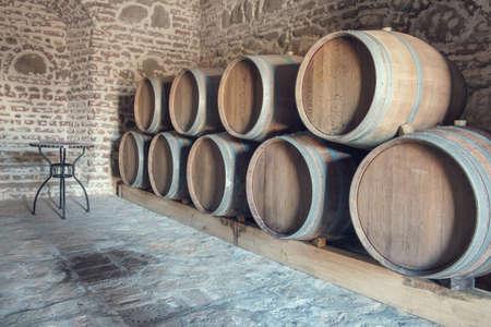 Row of oak barrels in a dry cool wine cellar in basement 版權商用圖片