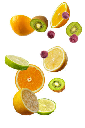 Falling fresh mixed citruses. Slices of the lemon, kiwi, cherry and lime the air. Flying fruits concept isolated on the white background