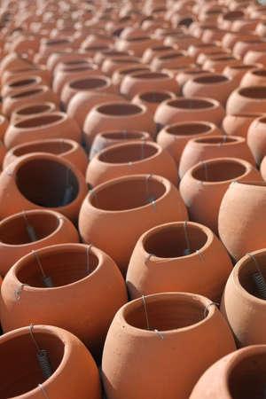 Rows of ceramic clay pots, selective focus